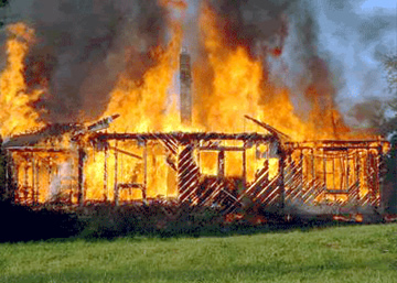 Timber home on fire